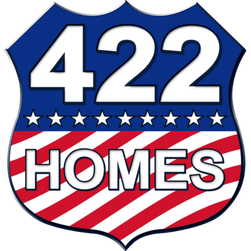 422 Homes Logo, a shield with an American Flag design on it